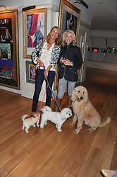 Left to right, ELENA MOJDEHI and HOLLY PETERSON and their dogs at the 10th anniversary of George in association with The Dog's Trust held at George, 87-88 Mount Street, Mayfair, London on 13th September 2011.