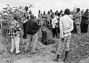 Joyce Tembo died from AIDS in Lusaka, Zambia. She was 37 years old.<br />Members of The Tembo Family along with people from the community share the digging duties, preparing the grave for burial.