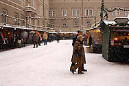 People at a snowy Christmas market in Salzburg Austria .<br /> <br /> Visit our AUSTRIA PHOTO COLLECTIONS for more photos to download or buy as wall art prints https://funkystock.photoshelter.com/gallery-collection/Pictures-Images-of-Austria-Photos-of-Austrian-Historic-Landmark-Sites/C0000VRQ9JIAzOxc