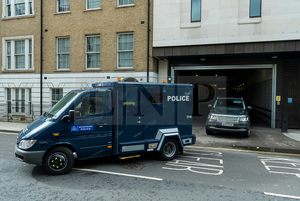 © Licensed to London News Pictures. 13/03/2021. LONDON, UK.  A police van believed to be carrying Wayne Couzens, 48, a serving Met Police officer, departs Westminster Magistrates' Court after he was charged with the kidnap and murder of Sarah Everard, who disappeared as she walked home in south London.  The 33-year-old's body was found in woodland in Kent more than a week after she was last spotted on 3 March.   Photo credit: Stephen Chung/LNP