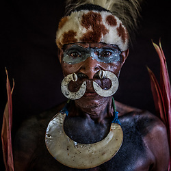Crocodile Festival Ambunti 2018. Known as one of the largest rivers in the Asia-Pacific region theSepik River is home to some of the world's largest freshwater and saltwater crocodile populations. The Sepik River Crocodile Festival highlights the importance of the crocodile and its cultural significance to the people of the Sepik River. The Crocodile symbolizes strength, power and manhood. Skin-cutting initiations continue in Sepik River communities where men proudly wear scars cut into their skin during the rite of passage. These scars, resembling the back of a crocodile, run from the shoulder to the hip. Crocodiles are significant to the Sepik culture where they have cultural traditions, beliefs and legends based on this ancient animal. The Insect Tribe from Swagup Village, some hours upstream from Ambunti during their performance. The Swagup people are fierce crocodile hunters and among the main suppliers of Crocodile skin for Ismael's farm in Pagwi.
