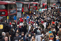© Licensed to London News Pictures. 12/12/2020. London, UK. Christmas shoppers flock to Oxford Street . Nearby Regent Street has been pedestrianised for the day. Experts are warning that London should be placed in tier three now to avoid a rise is coronavirus deaths over the Christmas period. Photo credit: Peter Macdiarmid/LNP