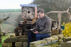 Licensed to London News Pictures 30/11/2016<br /> Artist Robert E. Fuller of Thixendale, North Yorkshire, has gone to unusual lenghts to get close to the animals he paints.  He has installed a 7m tunnel from his living room to his hide in the garden so he can reach it without disturbing the animals.  At work in the garden<br /> See story at<br /> www.samatkinsphoto.co.uk/download/ArtistTunnelStory/default.htm<br /> Photo Credit: Sam Atkins/LNP