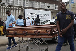 South Africa - Durban - 14  September 2020 -  Members of Nafupa carrying a coffin outside government mortuary at Gale street in Durban during a national strike of the funeral parlour.<br /> Picture: Bongani Mbatha/African News Agency(ANA)