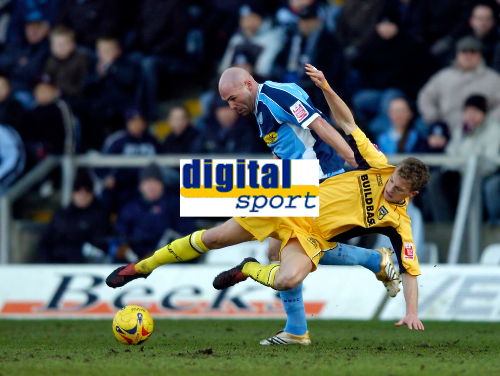 Photo: Richard Lane.<br />Wycombe Wanderers v Oxford United. Coca Cola League 2. 25/02/2006. <br />Wycombe's Tommy Mooney is tackled by Oxford's Lee Mansell.