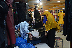 June 17, 2017 - Kolkata, West Bengal, India - Indian Muslim woman buying  cloths  for  Eid ul Fitr festival  in Kolkata, India on Saturday , 17th June , 2017. Muslims around the world are celebrating Eid ul Fitr to mark the end of the holy fasting month of Ramadan. (Credit Image: © Sonali Pal Chaudhury/NurPhoto via ZUMA Press)