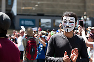 A man wears a Guy Fawkes mask during the Melbourne Freedom Rally at Parliament House. Police move into position on the steps of state parliament ahead of a planed protest. The groups who have organised the many Freedom Day protests over the last 3 months, attempted to march on State Parliament during Melbourne Cup Day demanding the sacking of Premier Daniel Andrews for the lockdown and attacks on their civil liberties. Police met with the protester's with significant force despite the city having had zero cases for five days. (Photo by Dave Hewison/Speed Media)