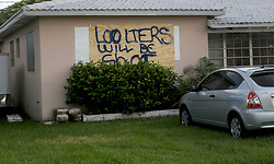 A homeowner in Dania Beach has a stern warning painted on his boarded up window ahead of Hurricane Irma.  (Mike Stocker/Sun Sentinel/TNS/Sipa USA)<br />