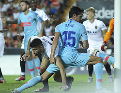 August 20, 2018 - Piccini of Valencia and  Savic of Atletico de Madrid in action during the spanish league, La Liga, football match between ValenciaCF and Atletico de Madrid on August 20, 2018 at Mestalla stadium in Valencia, Spain. (Credit Image: © AFP7 via ZUMA Wire)