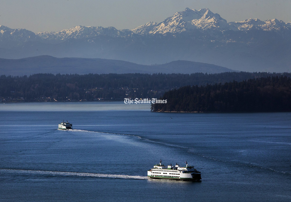 Under sunny skies, ferries come and go from the Fauntleroy Ferry Terminal in West Seattle. (Ellen M. Banner / The Seattle Times)