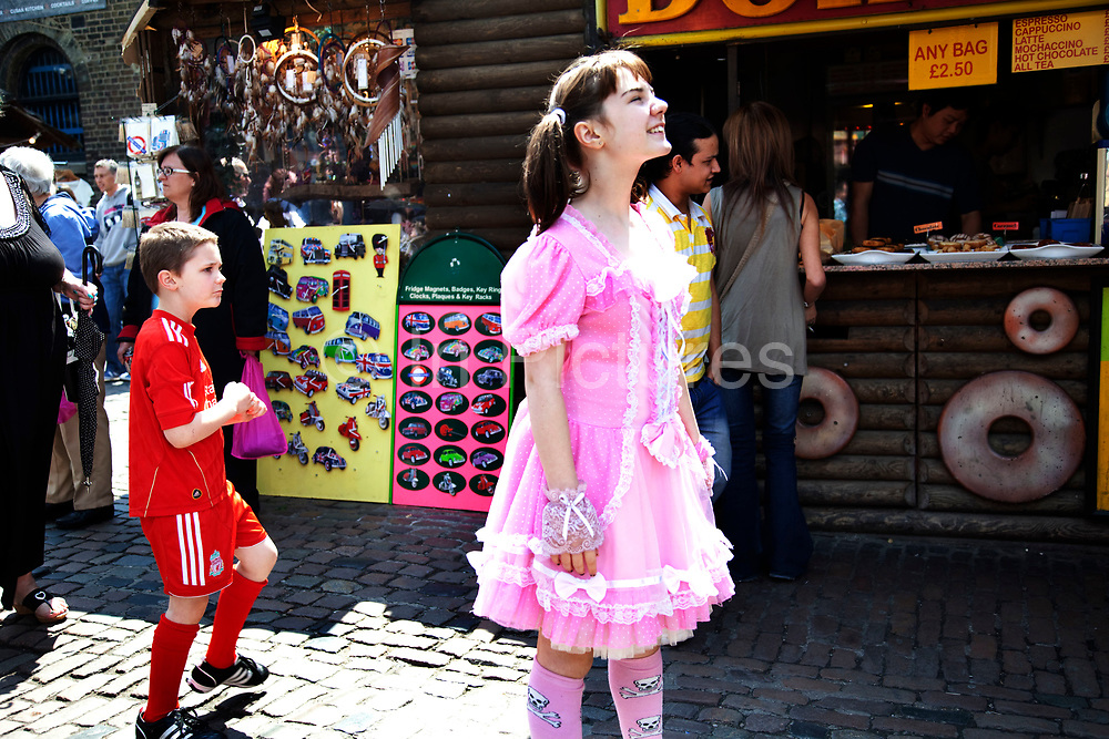 Georgia (11, wearing a pink Lolita dress) and son Kiefer (8, wearing a red Liverpool Football Club kit) spending a day out together in Camden Town, North London. They arrive at their favourite shop and are pretty excited at the prospect. Louise is on various benefits to help support her family income, and housing, although recent government changes to benefits may affect her family drastically, possibly meaning they may have to move out of London. Louise Ryan was born on the Wirral peninsula in 1970.  She moved to London with her family in 1980.  Having lived in both Manchester and Ireland, she now lives permanently in North London with her husband and two children. Through the years Louise has battled to recover from a serious motorcycle accident in 1992 and has recently been diagnosed with Bipolar Affective Disorder. (Photo by Mike Kemp/For The Washington Post)
