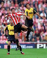 Gilles Grimandi (Arsenal) jumps with Niall Quinn (Sunderland). Sunderland 1:0 Arsenal. FA Premiership,19/8/2000. Credit Colorsport / Stuart MacFarlane.