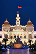 The People's Committee Building in downtown Ho Chi Minh City (Saigon), Vietnam. The building is also known as the Ho Chi Minh City Hall. A statue of Ho Chi Minh sits in the park in front of the building.
