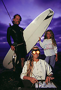A mom uses the Synchro-Energizer on Cardiff Beach, Southern California, with her daughter and surfer, spear-fishing husband, at dusk. MODEL RELEASED [1988].