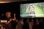 Leda Garside with photo of Patricia Green, Patrician Green Cellars, Salud Oregon pinot noir auction 2017