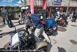 Craig Jackman at a gas stop at the Pine Junction, CO Country Store with his 1936 HD VLH Twin Carb during Stage 9 (249 miles) of the Motorcycle Cannonball Cross-Country Endurance Run, which on this day ran from Burlington to Golden, CO., USA. Sunday, September 14, 2014.  Photography ©2014 Michael Lichter.