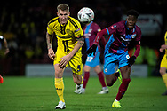 Burton Albion defender Kyle McFadzean & Scunthorpe United forward Ike Ugbo gives chase during the The FA Cup 1st round match between Scunthorpe United and Burton Albion at Glanford Park, Scunthorpe, England on 10 November 2018.