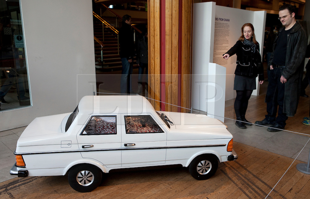 © Licensed to London News Pictures. 22/01/2012. London, U.K..Mercedes Benz coffin, by Paa Joe..Boxed Exhibition at the Royal Festival Hall on the South Bank, London, showing fabulous weird and whacky coffins from the UK and Ghana..Photo credit : Rich Bowen/LNP