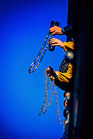 Tossing beads from a balcony on Bourbon Street, Mardi Gras, French Quarter, New Orleans, Louisiana USA