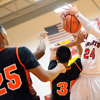013114  Adron Gardner/Independent<br /> <br /> Grants Pirate Eric Rael (24), right, pulls down a rebound from the Gallup Bengals in Grants Friday.