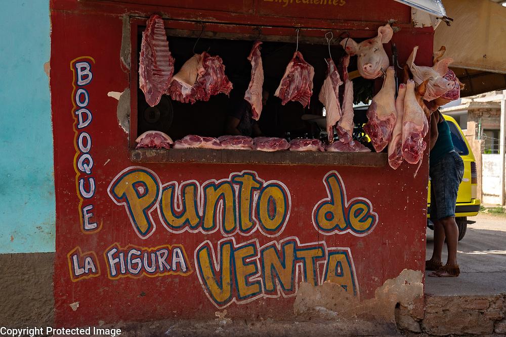 Open air meat market, Sancti Spiritus, Cuba 2020 from Santiago to Havana, and in between.  Santiago, Baracoa, Guantanamo, Holguin, Las Tunas, Camaguey, Santi Spiritus, Trinidad, Santa Clara, Cienfuegos, Matanzas, Havana
