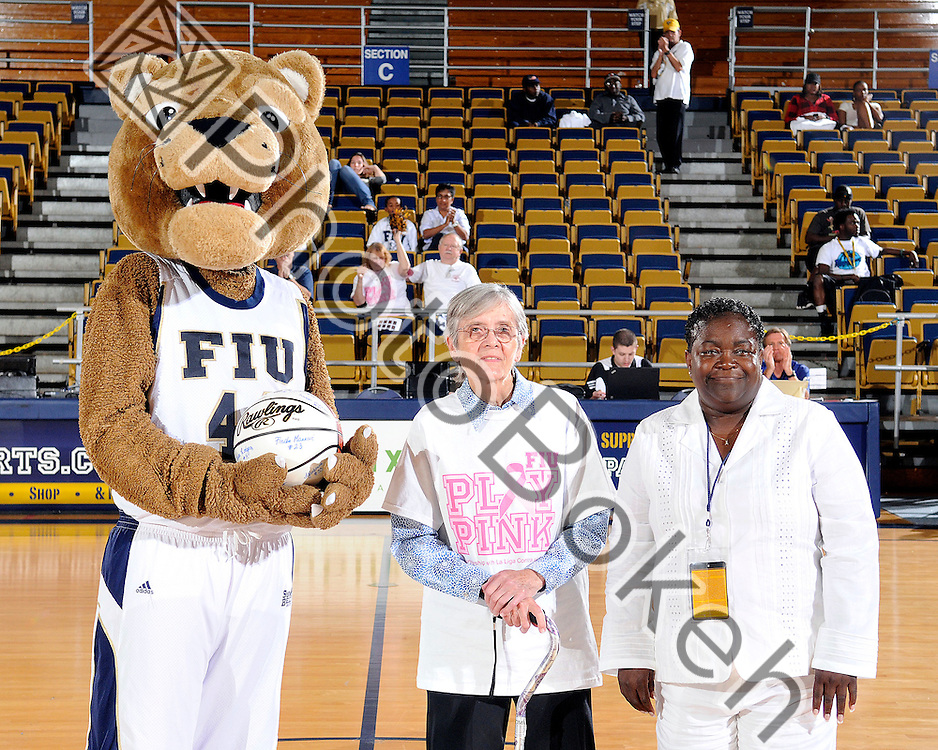 2011 February 26 - Roary presenting a signed basketball to cancer survivors. Florida International University Women's Basketball team defeated the Troy Trojans, 71-47, for the first time in nine years at the U.S. Century Bank Arena, Miami, Florida