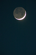 The crescent moon above Middletown, N.Y, with the dark section lit by earthshine: sunlight reflected off of the earth. May 10, 2005.