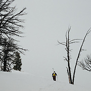 Natalie Segal climbs up Glory for some early season skiing in the Tetons near Wilson, Wyoming.