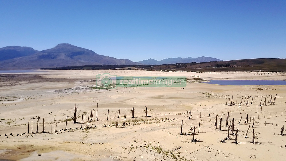 This image is of the Theewaterskloof Dam.  The dam is one of the six that supply Cape Town with its water supply.  On the 3rd March 2017 the City of Cape Town declared the drought a local disaster.  The dam levels are currently at 31% with the last 10% effectively unusable this means Cape Town water levels are at 21%.  This leaves the city with around 113 days of water left.<br /> <br /> Photo by:  Ron Gaunt / RealTime Images