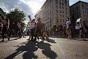 Protestors march down 16th Street towards the White House during demonstrations over the death of George Floyd on June 6, 2020 in Washington, United States.
