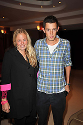 ASTRID HARBORD and JAMES ROTHSCHILD at a screening of the short film 'The Volunteer' held at the Courthouse Hilton Hotel, 19-21 Great Marlborough Street, London W1 on 26th October 2009.