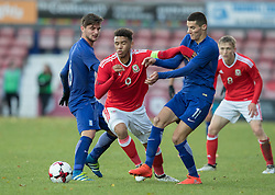 WREXHAM, WALES - Thursday, November 10, 2016: Wales' Tyler Roberts in action against Marious Vrousai of Greece during the UEFA European Under-19 Championship Qualifying Round Group 6 match at the Racecourse Ground. (Pic by Gavin Trafford/Propaganda)