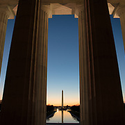 WASHINGTON, DC--Around the time of the spring and fall equinox, with the sun rising directly in th east during that time, the rising sun shines in directly on the statue of Abraham Lincoln inside the Lincoln Memorial. Standing on the western end of the National Mall in Washington DC and next to the Reflecting Pool looking towards the US Capitol Building, the Lincoln Memorial was dedicated in 1922 and is one of Washington DC's most famous landmarks.