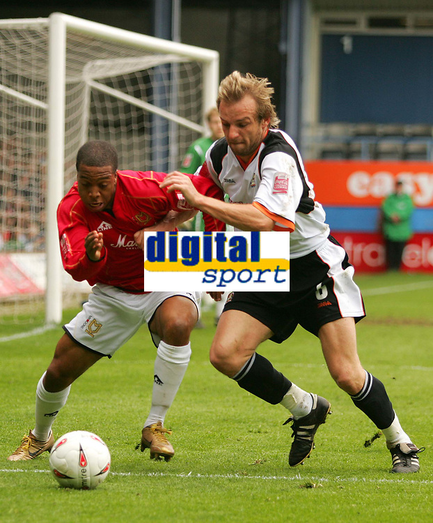 Photo:  Frances Leader.<br /> Luton Town FC v Milton Keynes Dons. The Coca-Cola League One. Kenilworth Road.<br /> 16/04/05<br /> The Dons Wade Small with the ball against Lutons' Paul Underwood.