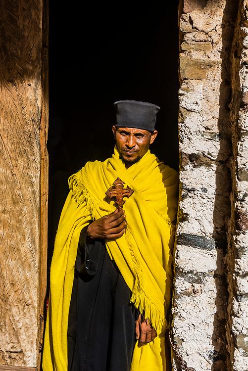 A monk stands outside the Debre Birhan Selassie Church, Gondar, Ethiopia.