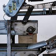Closeup of old conveyor belt equipment in factory.