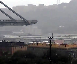 August 14, 2018. - Genoa, Italy - A highway bridge  has partially collapsed, prompting fears of injuries and deaths. (Credit Image: © Fotogramma/Ropi via ZUMA Press)