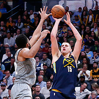 05 April 2018: Denver Nuggets center Nikola Jokic (15) takes a jump shot over Minnesota Timberwolves center Karl-Anthony Towns (32) during the Denver Nuggets 100-96 victory over the Minnesota Timberwolves, at the Pepsi Center, Denver, Colorado, USA.