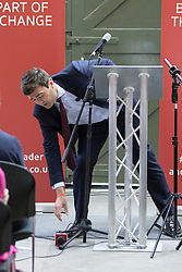 © Licensed to London News Pictures . 17/08/2015 . Manchester , UK . Labour party leadership contender , ANDY BURNHAM knocks a microphone from his podium whilst delivering a speech at the People's History Museum in Manchester this morning (Monday 17th August 2015) . Photo credit : Joel Goodman/LNP