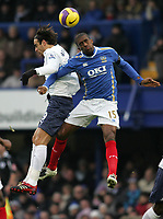Photo: Lee Earle/Sportsbeat Images.<br /> Portsmouth v Tottenham Hotspur. The FA Barclays Premiership. 15/12/2007. Portsmouth's Sylvain Distin (R) clashes with Dimitar Berbatov.