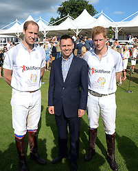 Left to right, HRH THE DUKE OF CAMBRIDGE, MARTIN SANDER and HRH PRINCE HARRY OF WALES at the Audi Polo Challenge 2013 at Coworth Park Polo Club, Berkshire on 3rd August 2013.