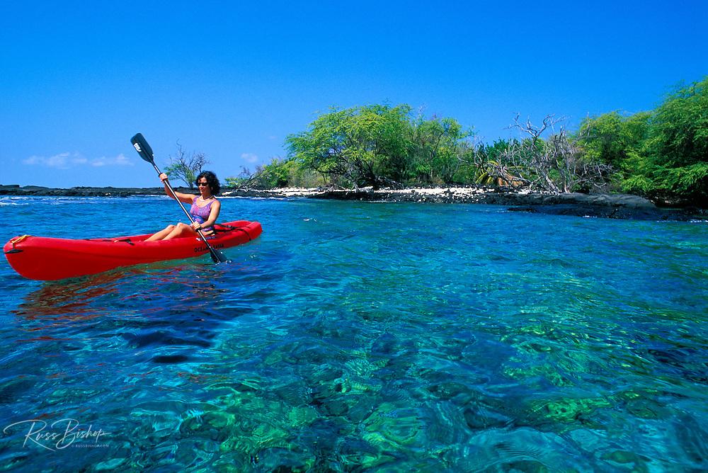 Woman kayaking on Kealakekua Bay near the Captain Cook Monument, The Big Island, Hawaii
