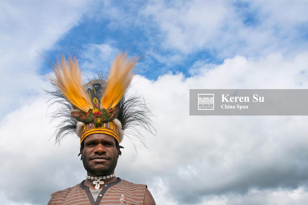 Dani man wearing feather head dress, Papua, Indonesia