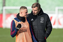 (L-R) Noa Lang of Jong Ajax, assistent trainer Richard Witschge of Ajax during the trainings session of Ajax Amsterdam at the Toekomst on January 30, 2018 in Amsterdam, The Netherlands