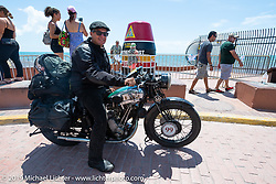 Todd Cameron stops in front of the landmark Key West buoy while riding his 1930 BSA Sloper in memory of his Grandfather, JD John Cameron, the motorcycle racer, restorer and founding member of the Boozefighters MC. Cross Country Chase motorcycle endurance run from Sault Sainte Marie, MI to Key West, FL. (for vintage bikes from 1930-1948). Riding through town just before at the end of the 110 mile Stage-10 ride from Miami to Key West, FL USA. Sunday, September 15, 2019. Photography ©2019 Michael Lichter.