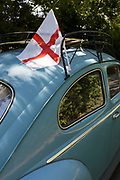 In the aftermath of the 2018 World Cup in Russia, an English flag is still on the roof of a classic German Volkswagen car, on 15th July 2018, in London, England.