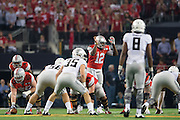 Cardale Jones #12 of the Ohio State Buckeyes calls a play at the line of scrimmage against the Oregon Ducks during the College Football Playoff National Championship Game at AT&T Stadium on January 12, 2015 in Arlington, Texas.  (Cooper Neill for The New York Times)