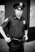 A cop in the street, Time Square. New York City, 23 june 2010. Christian Mantuano / OneShot
