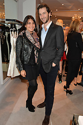 The HON.WILLIAM ASTOR and his wife LOHRALEE at a party at Herve Leger, Lowndes Street, London on 12th November 2014 to view the latest collection.