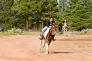 """09 SEPTEMBER 2007 -- ST. MICHAELS, AZ: CONRAD WHITEHORSE, from Many Farms, AZ, had a wide lead at the finish of a one mile race at a traditional Navajo Horse Race in the summit area of the Navajo Indian reservation about 10 miles west of St. Michaels, AZ. Traditional horse racing is making a comeback on the Navajo reservation. The races are run on improvised courses that vary depending on the local terrain. Use of saddles is optional (except in the """"Cowhand Race"""" which requires a western style saddle) and many jockeys ride bareback. The distances vary from one mile to as long as thirty miles. Traditional horse races were common until the 1950's when they fell out of favor, but there has been a resurgence in traditional racing since the late 1990's and now there is a traditional horse racing circuit on the reservation. The race was organized by the Begay family of Steamboat, AZ and run on private land about three miles from a paved road.  Photo by Jack Kurtz"""